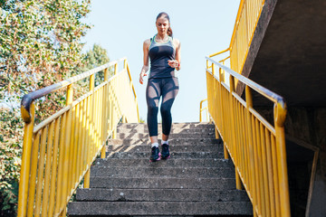 Girl running down the stairs during exercise
