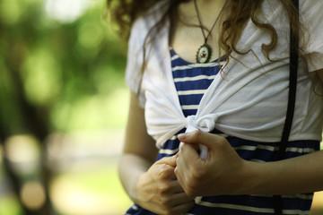 Fototapeta torso girl in a striped T-shirt