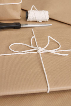 Parcel packing materials with brown paper string and scissors