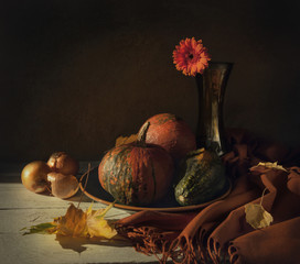 Still life with pumpkins and flower