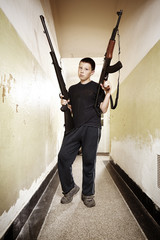 Teenage boy with two guns