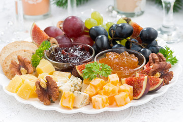 delicious cheese and fruit plate to the holiday