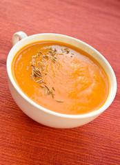 Vegetarian carrot-pumpkin cream soup with garlic and cumin