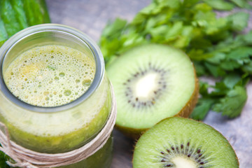 Green smoothie with cucumber, apples and kiwi