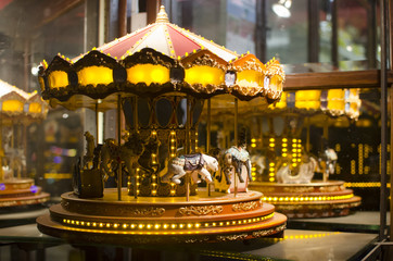 carousel ornament at night with lights