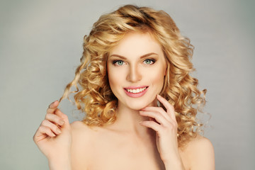 Pretty Girl with Curly Hair and Toothy Smile. White Teeth, Blond