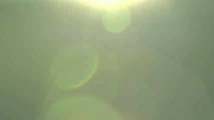 Fotoväggar - Spring field. Blurred abstract bokeh with sun flare. Sunlight.