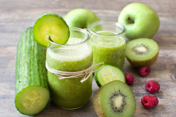 Green smoothie with cucumber and raspberries