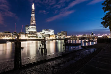 View of the shard at night from the bank of the river Thames