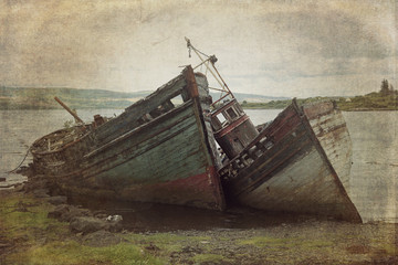 Old boads aground in Isle of Mull