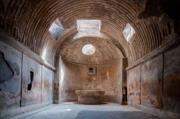 Wall Mural - Remains of the public baths in Pompeii . Italy - Pompei was dest