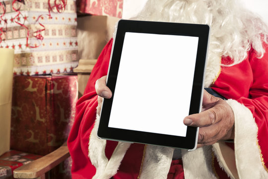 Snata Claus Holding a Digital Tablet
