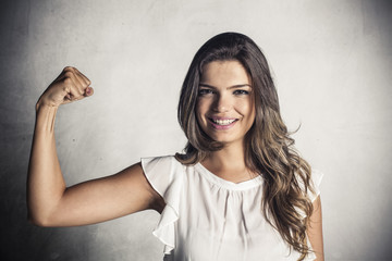 Beautiful girl showing victory gesture