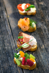Delicious tapas on a wooden background