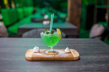 lemonade with lime, mint on a wooden table