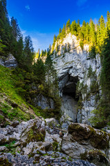 Cetatile cave sculpted by river in romanian mountains