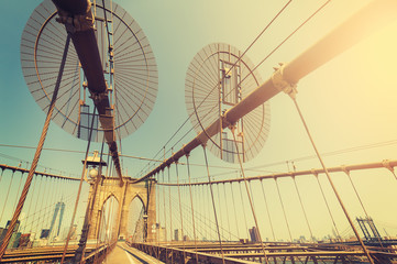 Vintage toned fisheye lens picture of Brooklyn Bridge, NYC, USA.