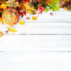 autumn background with colored leaves on wooden table