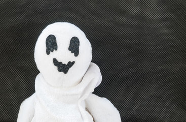 cute ghost doll on fabric background