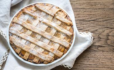 Pumpkin pie on the wooden background