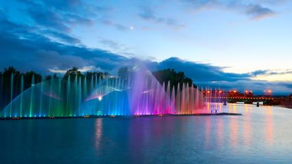 Beautiful fountain at night illuminated with blue light. Vinnyts