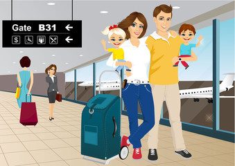 happy couple with children in an airport