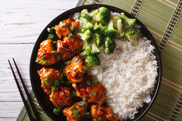 Tso's chicken with rice, onions and broccoli closeup. horizontal top view
