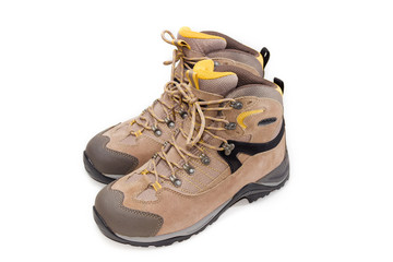 Light brown trekking shoes on a light background