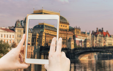 Taking shot of famous Prague historical sight with a tablet.