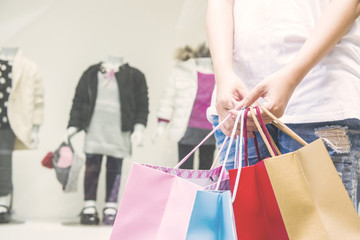 Happy Women holding shopping bags