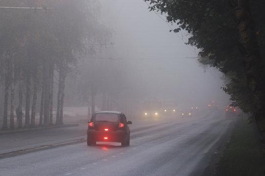 blurred background autumn fog on city road