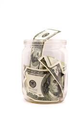 glass jar with dollars