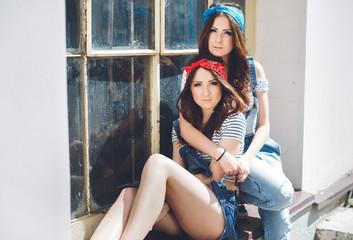 pretty twins sisters wearing bandanas, stylish jeans overalls