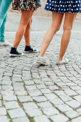 Three girls walking on the street