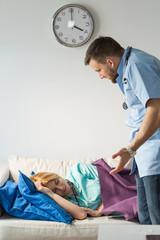 Doctor calling sleeping nurse