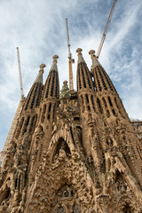 Ornate Facade of Sagrada Familia with Cranes