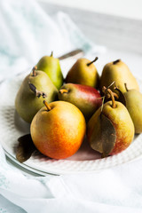 Autumn pears on white pastel background