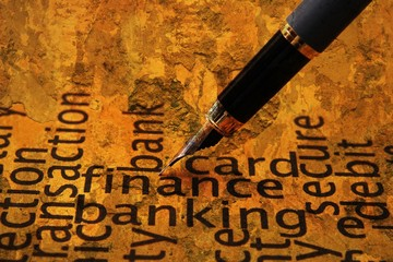 Fountain pen on finance and banking text
