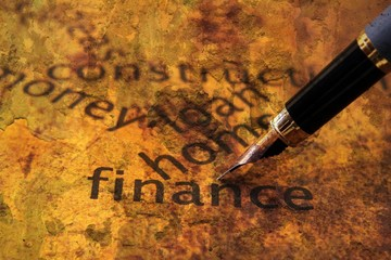 Fountain pen on home finance concept
