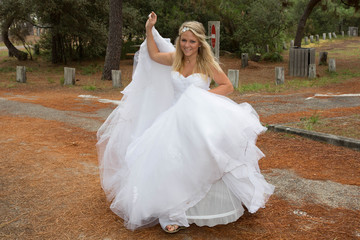 Beautiful and pretty bride with a white wedding dress