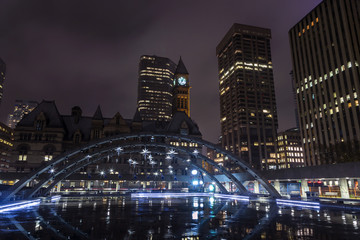 Toronto's Clock Tower from Nathan Phillips Square in downtown Toronto during the holiday season.