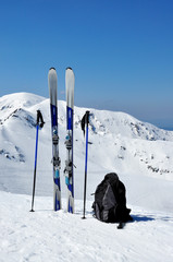 Skis, ski poles and backpack in Tatra mountains