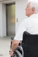 Man sitting on the wheelchair