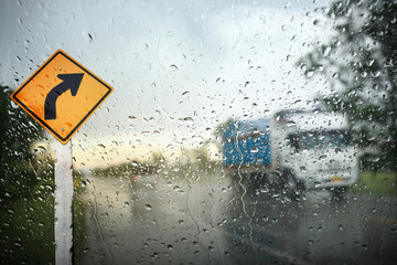 View through the wind shield of rainy day with bike lane sign,Shallow depth of field composition.
