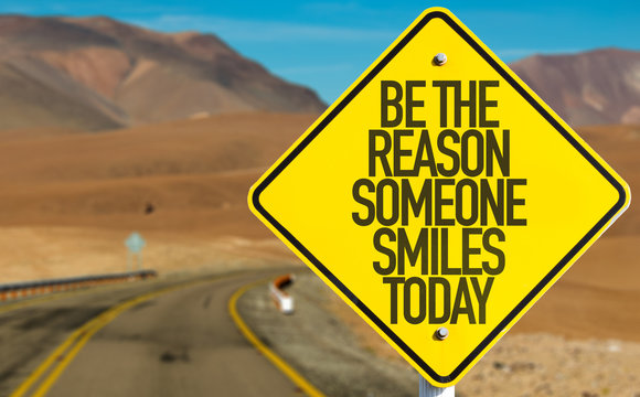 Be The Reason Someone Smiles Today sign on desert road