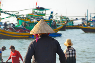 Typical vietnamese women in seaside village with conical hat
