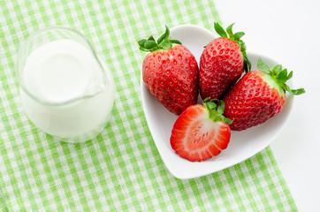Fresh strawberries and milk.