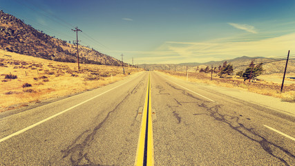 Retro old film style country highway in USA, travel adventure concept.