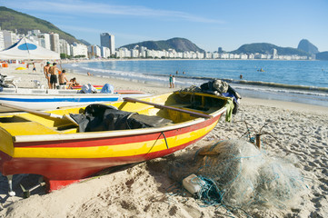 Colorful fishing boat and net on scenic view of Copacabana Beach in Rio de Janeiro, Brazil