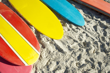 Stand up paddle long board surfboards in bright colors on Copacabana Beach Rio de Janeiro